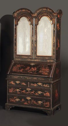 """A Rare Queen Anne Japanned Secretaire Cabinet, CIRCA 1710, Height: 7'9"""" Width: 41"""" Depth: 21 ½"""" - The pagoda-form cornice surmounted by gilt ball-form finials over two arched doors enclosing an arrangement of seven drawers; the lower section fitted with a secretaire drawer opening to pigeonholes and drawers, over three graduated drawers, on bun feet. Decorated throughout with chinoiserie decoration featuring a hunt scene of court figures and lions in pagoda landscape settings."""