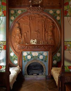 House-museum of the Casa Navas in Catalonia Furniture for the home in the 1900s was designed by Gaspar Omar. Fireplace tiled and surrounded by a wooden carving. Benches covered with sheepskin.
