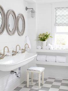 White Farmhouse Cottage Style Bathroom Get the look: Kohler Brockway sinks Cottage Style Bathrooms, Modern Farmhouse Bathroom, White Farmhouse, Farmhouse Style, Farmhouse Design, Farmhouse Sink In Bathroom, Trough Sink Bathroom, Large Bathroom Sink, Farmhouse Decor