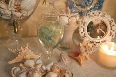 Love the apothecary jar with sea glass.