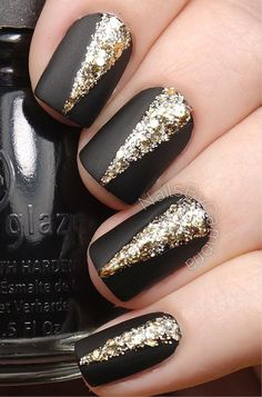 Black and glitter gold nail art design. Gives your matte black nails some attitude by adding v-shaped glitter gold polish in the middle.