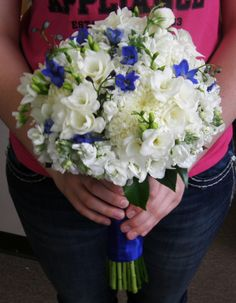 white and cobalt blue wedding reception | ... , lisianthus, dendrobium orchids, and some bits of blue delphinium
