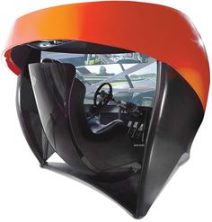 """The Full Immersion Professional Racer's Simulator claims to be the only simulator in the market with a 106""""-wide HD screen which stretches up to 180 degrees. The seamless 7 million-pixel screen covers halfway around the driver and displays the window net, side mirrors, and passed cars in the driver's peripheral vision, giving the complete cockpit experience"""
