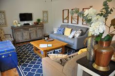 Living room with trellis rug, cedar coffee table, branch art, blue chest, antique paned windows Blue Chests, Branch Art, Trellis Rug, Bird Houses, Couch, Windows, Living Room, Interior Design, Rugs