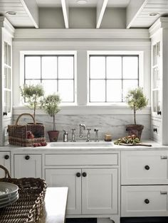Love the farmhouse white kitchens. The side cabinets are an amazing  idea!!