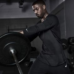 Hit the gym, street, then repeat. The Nike Training Utility Tee keeps Michael B. Jordan dry and comfortable in and out of the gym. Michael B Jordan Girlfriend, Michael Bakari Jordan, Motivational Picture Quotes, Bae, Man Crush Everyday, Training Tops, Black Panther, Nike Dri Fit, Mens Fitness