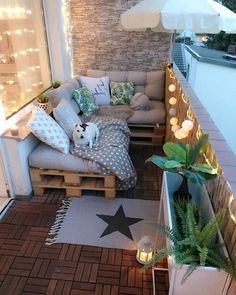 ▷ 1001 + ideas how to decorate the balcony like a professional d .- ▷ 1001 + Ideen wie Sie den Balkon dekorieren wie ein Profi Designer balcony ideas, decor lamps, carpets, pallet sofa with pillows, a dog lies on the sofa - Small Balcony Design, Small Balcony Decor, Small Patio, Balcony Ideas, Apartment Balcony Decorating, Apartment Balconies, Apartments Decorating, Apartment Ideas, Apartment Therapy
