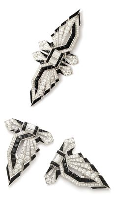 An Art Deco platinum, onyx and diamond double clip brooch, possibly American, circa 1925. Of geometric design set wtih faceted onyx and baguette and modern round brilliant diamonds, mounted in platinum. In the style of Janesich. Length 4 inches.