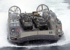 US Navy 030113-N-2972R-114 A Landing Craft Air Cushion (LCAC) Vehicle from Assault Craft Unit Four (ACU-4) transports Marine Assault Vehicles to Kearsarge.jpg