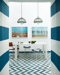 In the Marrakech home of Samuel and Caitlin Dowe-Sandes, owners of Popham Design, an indigo-striped entry hall leads to the dining room. Cement tiles of their own design line the floors. The vintage chairs are by Harry Bertoia and Mart Stam. Blue Rooms, White Rooms, Appartement Design, Striped Walls, Blue Walls, White Walls, House Design Photos, Home Design, Deco Design