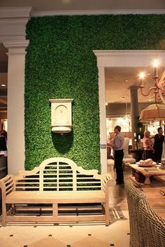 I LOVED the boxwood wall treatment used to decorate the Restoration Hardware store.  Made w/ boxwood mats.  The Tory Burch store now has a similar display.