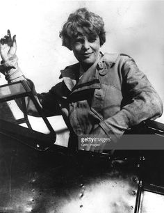 Amelia Earhart waves from the cockpit of her plane circa 1929. Carlene Mendieta, who is trying to recreate Earhart's 1928 record as the first woman to fly across the US and back again, left Rye, NY on September 5, 2001. Earhart (1898 - 1937) disappeared without trace over the Pacific Ocean in her attempt to fly around the world in 1937.