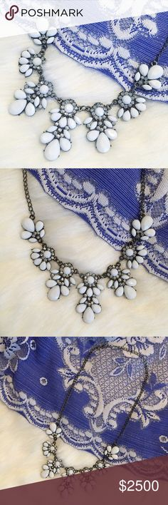"""""""Laurel"""" Necklace    White Floral Statement A gorgeous showstopper, the """"Laurel"""" statement necklace is perfect for a holiday party or to dress up a classic chambray button-up. With its unique floral arrangement of white & clear crystal rhinestones, you'll always be on trend in this piece! Made of lightweight metal alloy, this fashion bib necklace has a lobster clasp that connects to a gunmetal colored chain with a 2 - 2.5 inch extender. Unbranded. New with tags.  📷 ericarose1989 Jewelry…"""
