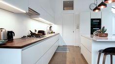 A white matt handleless German kitchen in Willesden Green, London. This is one of our recent projects. Howdens Kitchens, Handleless Kitchen, Kitchen Worktop, Kitchen Units, New Kitchen, White Kitchens, High Gloss White Kitchen, Open Plan Kitchen Diner, German Kitchen