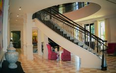 Elegant, double open curved staircase at the University of Alabama.