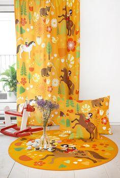 Vallila & Mimmit collection: Kevätlaulu, orange curtain, cushion and rug. Design Meri Mort & Vallila Design Studio