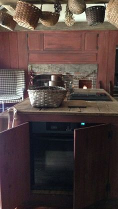 Build cabinets to hide appliances in your primitive kitchen