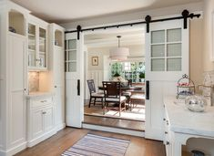 """Could we change door to """"treadmill room"""" to a single, or even hidden, then hang a barn door (with windows like this to let the light in) across the stairwell wall?"""