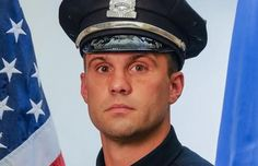 "Officer John Moynihan, 34, a highly decorated Boston police officer is fighting for his life after being shot in the face ""assassination-style"" by a violent career criminal. March 27, 2015"