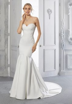 This Larissa satin mermaid wedding dress features a strapless sweetheart neckline. Satin Mermaid Wedding Dress, Fit And Flare Wedding Dress, Bridal Wedding Dresses, Designer Gowns, Designer Wedding Dresses, Net Gowns, Modern Minimalist Wedding, Bridal Boutique, Bridal Looks