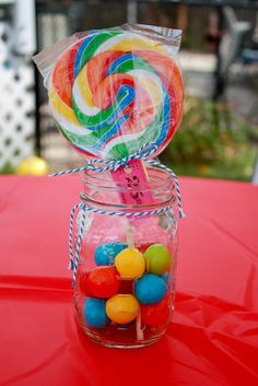 """Sweet Sucker Centerpieces: """"This wasn't what I originally planned to do for a centerpiece, but it totally came together at the last minute. So cute and fun!"""" Tiffany says.  Source: The TasteFull Life"""