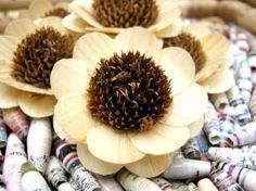 "These flowers are made of ""Birch Wood"" shavings that are shaped and beautifully crafted.Dried disk flower of a real Sunflower accents the middle."