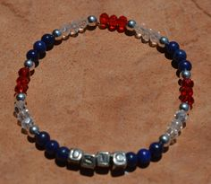 USMC Lapis Lazuli healing bracelet with Sterling Silver beads.  Show your pride and heal at the same time! by CrystalMeB on Etsy