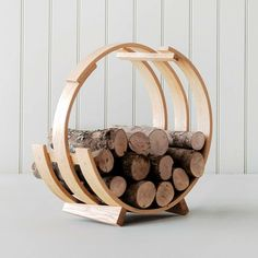 This Log Loop Wood Basket is a hand-crafted Tom Raffield creation. You can hardly call it anything but a creation, because it adds a touch of classic style to something as mundane as a basket for storing and carrying logs for the fireplace. Into The Woods, Fireplace Accessories, Home Accessories, Tom Raffield, Nordic Living Room, How To Bend Wood, Basket Lighting, Bent Wood, Bending Wood