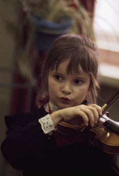 840050. A young student at a Moscow music school practices her violin. - NG Stock Photography