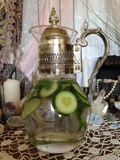 Aes - A pitcher filled with refreshing cucumber-mint water
