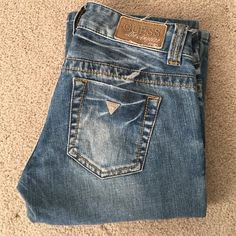 Guess women's bootcut jeans size 26/30 Guess bootcut women's jeans size 26/30. Light wash distressed. Excellent condition. Barely worn. Guess Jeans Boot Cut