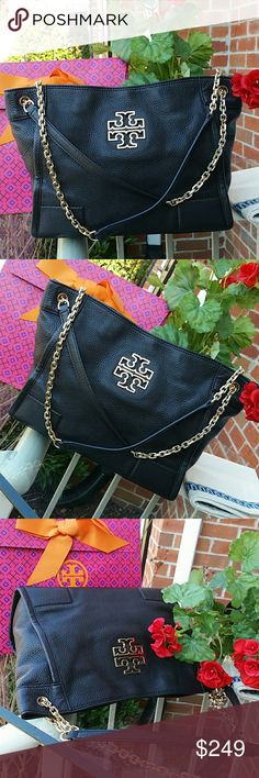 Authentic Tory Burch britten tote Very good condition. ...neat in and out... ..dimensions 14 in by 9.5 in by 4 in Tory Burch Bags