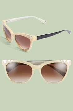 The shiny geometric hardware lend a retro-chic vibe to these statement-making gradient-lens sunglasses.