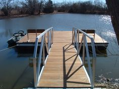 Wahoo floating aluminum platform features custom Wahoo aluminum and ipo wood benches.  Flat gangway with aluminum railing and cable anchoring connects the platform to shore.