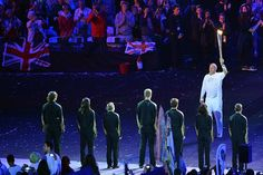 Former British rower and five times Olympic gold medalist, Steve Redgrave, passes the Torch to seven children, nominated to light the flame