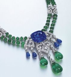 Sapphire, emerald, and diamond pendant necklace/brooch by Cartier