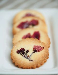 No Recipe, just a beautiful idea: edible flowers cooked into the tops of butter cookies.