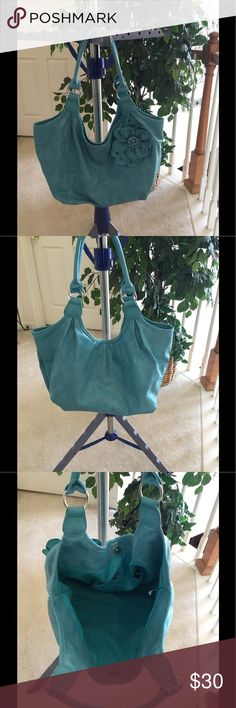 Teal Blue Elegant/Fun Hand bag Stunning Hand bag w/flower design on front of bag. Beautiful Teal Blue color.  Lots of room inside bag.  Has one zipper inside and two other pockets.  Very spacious.  Like new condition.  Looks like leather - 100% vinyl. Approximately 16 x 9.  Smoke free and pet free home.  Offers welcome.  Bundle and save. Bags Hobos