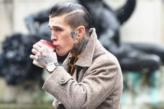 I love the tats against the classic tweed trench and stylish dressy watch. I'd definitely give a 2nd look to him.
