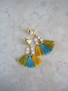 This pair of tassel earrings is my version of Bohemian earrings with a modern twist. The fringe tassels are made and strung onto the brass wires with beads, then carefully wire wrapped and attached to the earring posts. It is truly a unique and fun pair of boho style earrings to add
