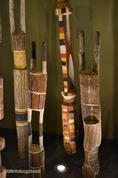 "These are called ""Pukamani Poles"" and represent individual people who have passed away incorporating a mourning process into their state of being from their birth, life, death, and rebirth. Australian Aboriginal."