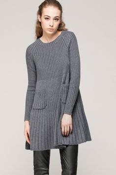Made from a wool-blend fabric. Raglan shoulders. Loose seam under the bust. Softly pleated skirt. Relaxed swing shape. About me:. 20% wool, 30% acrylic, 50% polyester.