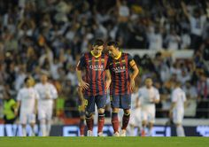 Lionel Messi (L) and Xavi Hernandez of Barcelona react after Real Madrid scored their opening goal during the Copa del Rey Final between Real Madrid and Barcelona at Estadio Mestalla on April 16, 2014 in Valencia, Spain.