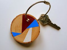 """* * *CHERRY BLOSSOM* * *  This handmade wooden keychain tag """"Cherry Blossom"""" welcomes the spring time! It is named for the blue sky, bright white clouds, and a cherry red flower that blossoms this time of year. I hand painted this geometric, color block design on a pine wood tree branch slice. It can be used for your keys, as a zipper pull, or as a backpack or purse accessory. By Florida0Keys on Etsy"""