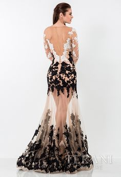 stunning   nude illusion evening gown with embellished two-tone lace appliques starting   at the long sleeves and continuing down the body, ending at the flared   hemline