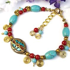 This colorful adjustable handmade bracelet features an eye-catching Tibetan-made brass inlay focal with turquoise and coral, which is combined with red bamboo coral rounds and turquoise-colored magnes