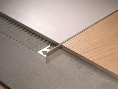 Find out all of the information about the PROFILITEC product: brass edge trim LINETEC PT. Condo Design, Floor Design, Wood Tile Floors, Kitchen Flooring, Tile Edge, Steel Frame Construction, Tile Trim, Metal Floor, Floor Trim