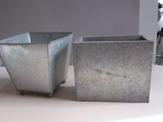 galvanized steel planter   You are looking at two galvanized metal planters. They have definitely ...
