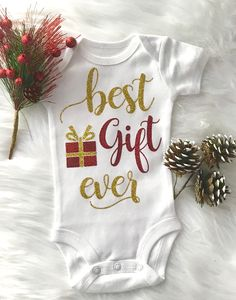 Sparkly Baby Girl Christmas Onesie You can either have this for your little one for Christmas or Yo Sparkly Baby Girl Christmas Onesie You can either have this for your little one for Christmas or Yo Kaitlyn Prencipe nbsp hellip Baby Christmas Onesie, Christmas Baby Announcement, Christmas Baby Shower, Newborn Christmas, Christmas Baby Clothes, Family Christmas Onesies, Christmas Outfits, 1st Christmas, Christmas Sweaters
