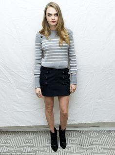 Legs eleven! Cara Delevingne showed off why she's also a model at the press conference for...